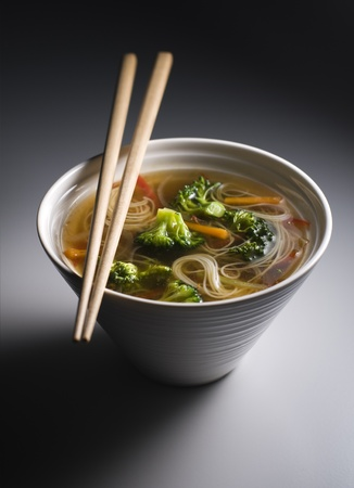 asian noodle: Fresh asian vegetable soup with noodles close up Stock Photo