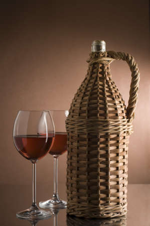 Bottle with red wine and two glasses photo
