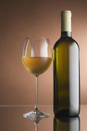 vintage bottle: Bottle with white wine and glass close up