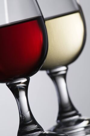 Red and white wine in glass close up shoot photo