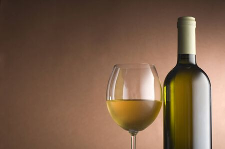 Bottle with white wine and glass close up 