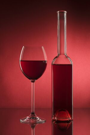 Glass of red wine and bottle close up shoot photo