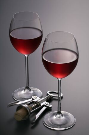 Red wine with corkscrew close up shoot photo