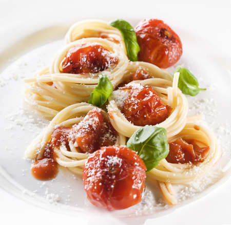 Pasta with tomato sauce basil and grated parmesan Stock Photo