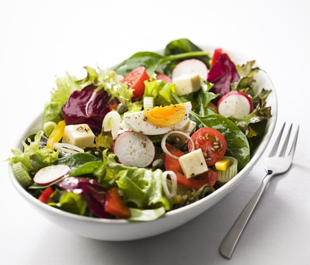 salad fork: Fresh mixed salad with egg close up Stock Photo