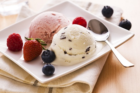 ice cream scoop: Fresh fruit and stracciatella ice cream close up Stock Photo
