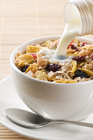 cornflakes: Fresh corn flakes, muesli and milk close up   Stock Photo