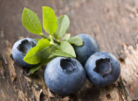 Fresh blueberries on wooden background close up Stock Photo