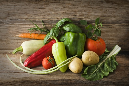 rustic food: Fresh organic vegetables on a table close up