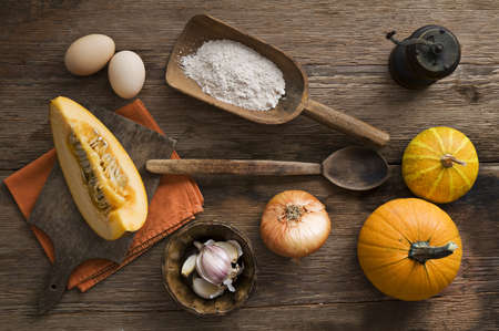 Pumpkin soup ingredients on wooden background close up Stock Photo - 11049363