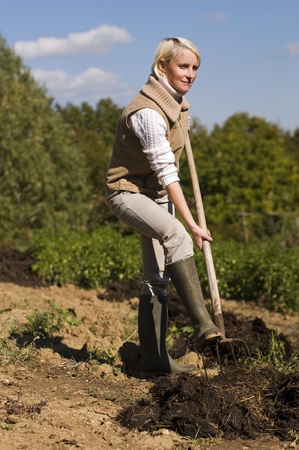 Young woman working on a farm close up shoot photo