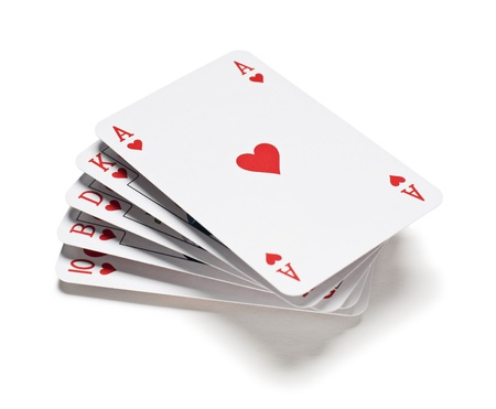poker hand: A royal straight flush playing cards on white
