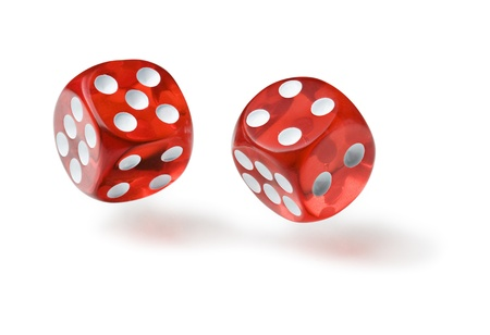 double the chances: Red dices in midair on white background close up