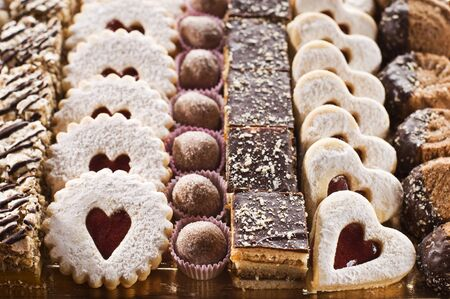 Assorted selection of biscuits in festive background photo