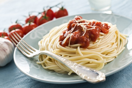 Fresh spaghetti with tomato sauce close up photo