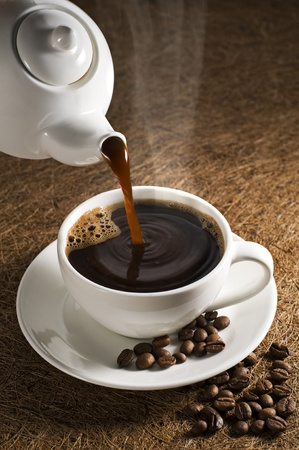 Hot cup of coffee close up shoot photo