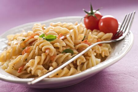 the corn salad: Fresh pasta with tomato sauce close up Stock Photo