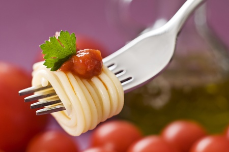 Spaghetti with tomato on fork close up shoot Stock Photo - 12041686