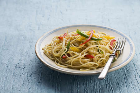Spaghetti with colorful peppers close up shoot Stock Photo - 12949320
