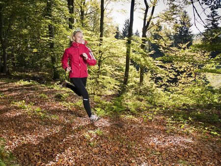 Young woman running in forest close up photo