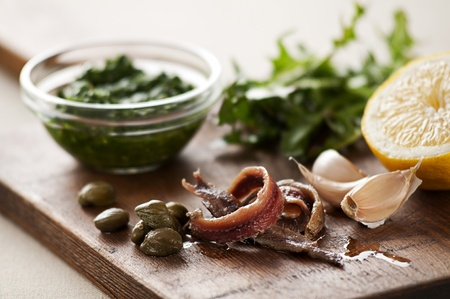 capers: Anchovies with capers, garlic and lemon close up Stock Photo