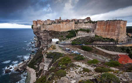 Bonifacio, old town at sea cliff, Corsica - France photo