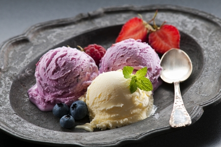 Fresh ice cream on vintage plate close up shoot photo