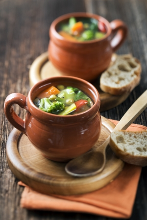 Vegeterian soup on wooden background close up photo