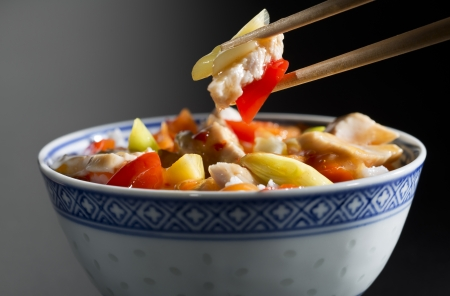 chinese bowl: Rice with chicken and vegetables close up