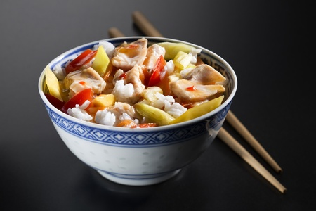 Rice with chicken and vegetables close up photo