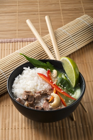 Chinese soup with rice, beef and vegetables close up photo
