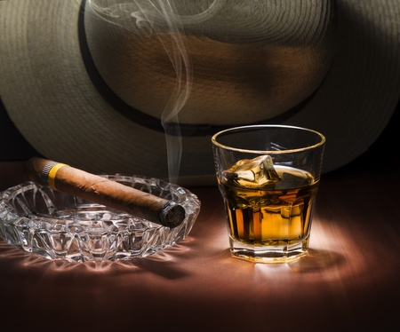 Cuban style rum and cigar close up photo