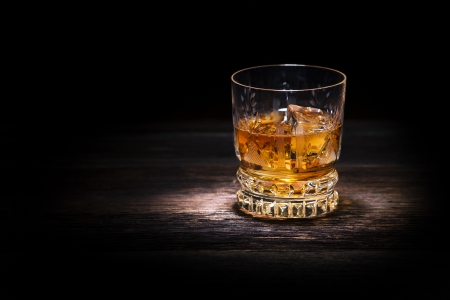 Glass of whiskey on wooden background close up Stock Photo - 17659185