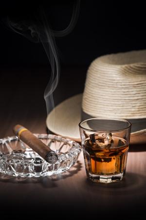 cigar smoke: Cuban style rum and cigar close up