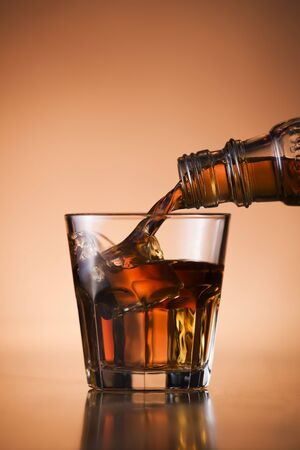 drunks: Whiskey pouring into glass close up shoot Stock Photo