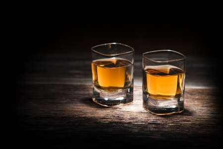 Glass of whiskey on wooden background close up Stock Photo - 17788236