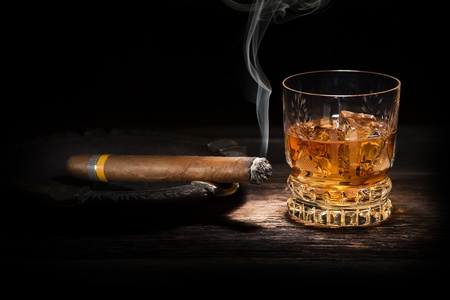 drunks: Whiskey and cigar on wooden background close up