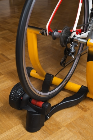 home trainer: Home indoor training on a cycle trainer close up