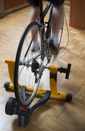 Home indoor training on a cycle trainer Banco de Imagens