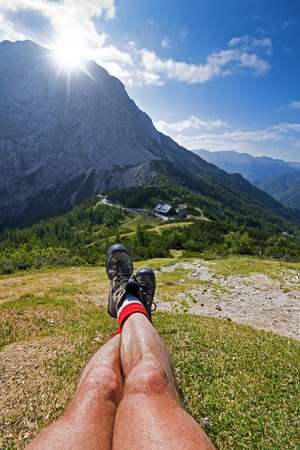 Hiker resting in mountains on a beautiful sunny day  photo