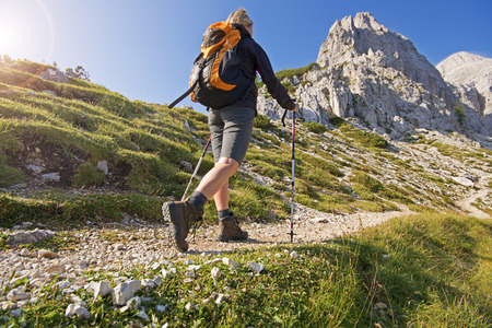 nordic: Young woman on a sunny day hiking in high mountains Stock Photo