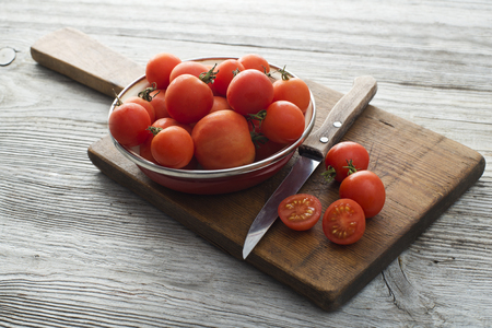 tomatos: Fresh tomatoes on wooden board close up shoot