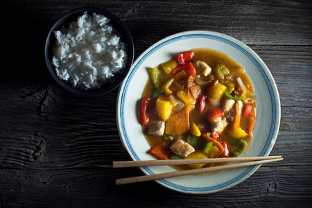 Chinese chop suey on wooden background close up shoot photo