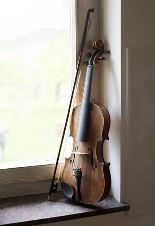 bow window: Violin beside window light close up shoot