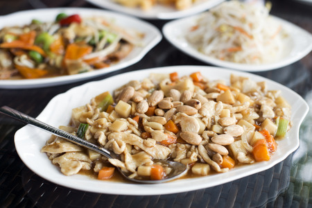 chicken rice: Chicken chop suey with almonds close up shoot Stock Photo