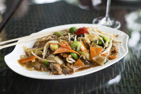 Traditional duck chop suey in restaurant close up photo