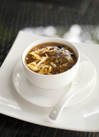 Sweet and sour chinese soup in restaurant close up photo