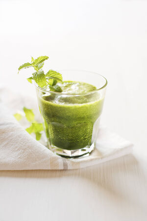 Glass of Healthy green smoothie with vegetables photo