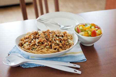 Fresh pasta with chanterelle mushrooms and spices in the table photo