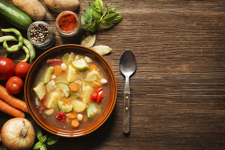 chicken soup: Fresh vegetable stew on wooden background overhead shoot